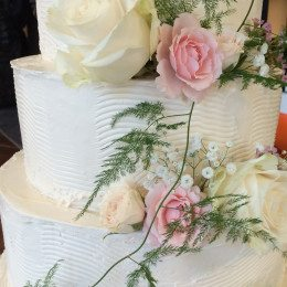 Using everyday tools from your local hardware store to design this stunning buttercream wedding cake.