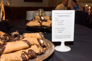 The cannoli bars come with a pastry chef to serve!