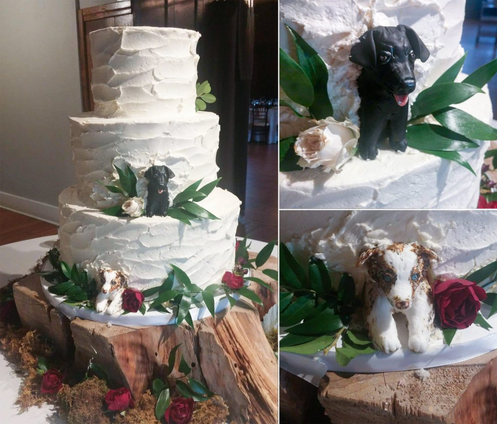 Dogs peeking out of the wedding cake.